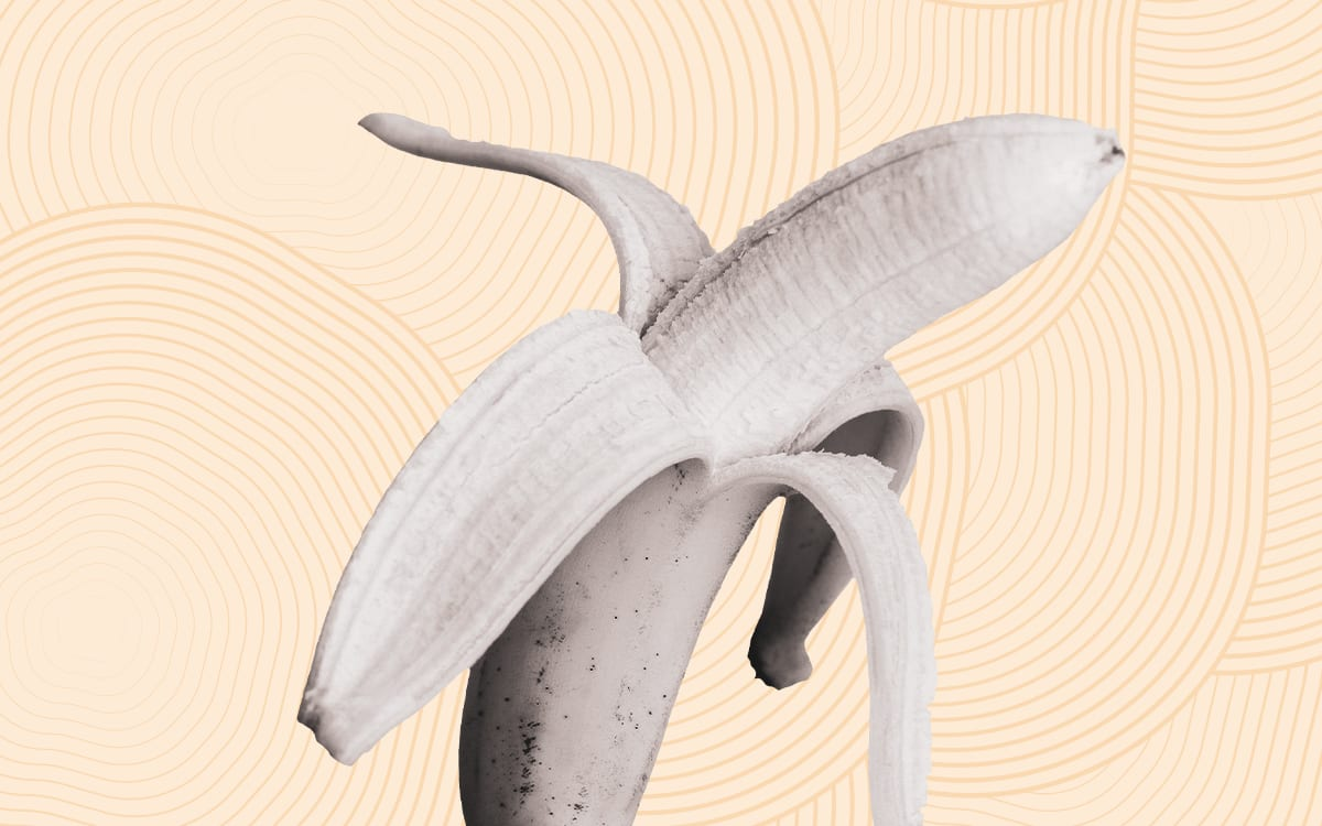 Half peeled banana on a yellow background with circles and lines.